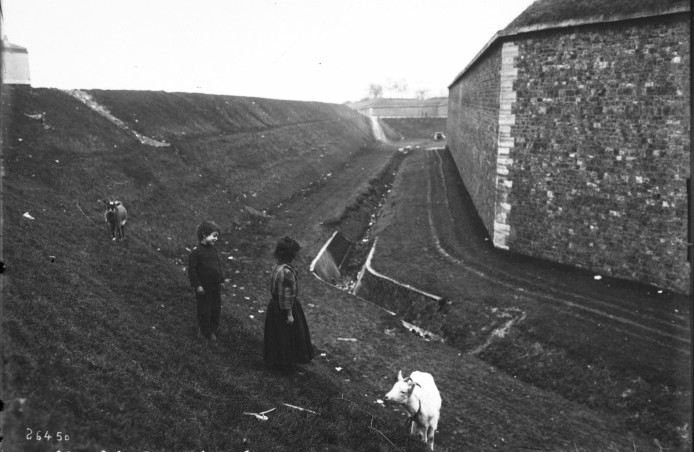 Public Domain: Children Play Along Thiers Wall circa 1890